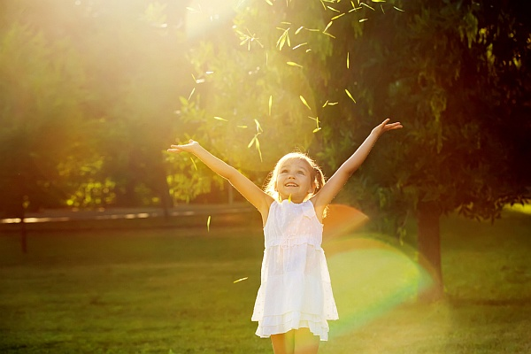Girl playing in the sun (photo from Shutterstock)