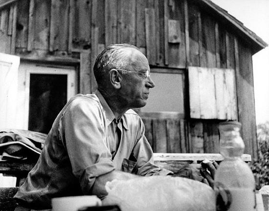 Aldo Leopold at his Salk County shack, around 1940 (photo from Univ of Wisconsin Digital Archives)