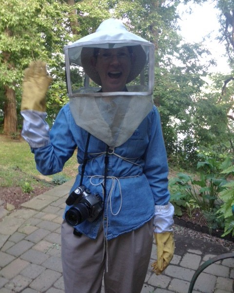Kate St. John in beekeeping gear (photo by Joan Guerin)