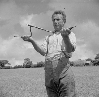 George Casely dowsing for water on his Devon farm, 1942 (photo from Wikimedia Commons)