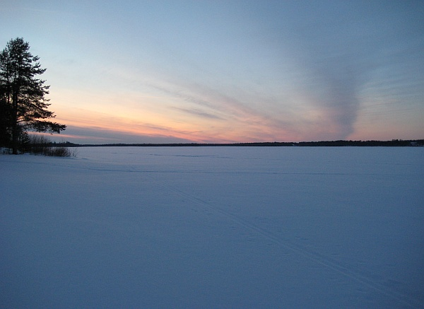 Sunset at frozen Pudasjärvi lake, Finland (photo from Wikimedia Commons)