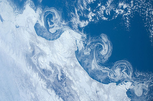 Ice flows off the Kamchatka coast (photo from the International Space Station via Wikimedia Commons)