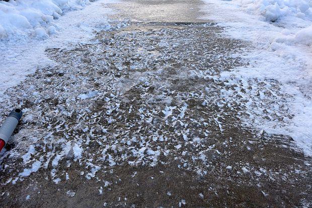 Icy sidewalk, 2 Mar 2015 (photo by Kate St. John