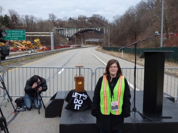 Sally Scheidlmeier just before she pushed down the plunger to blow up the bridge (photo by Geoff Campbell)