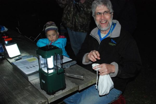 Bob Mulvihill at the owlbanding picnic table. There's a northern saw-whet in the white bag (photo by Donna Foyle)
