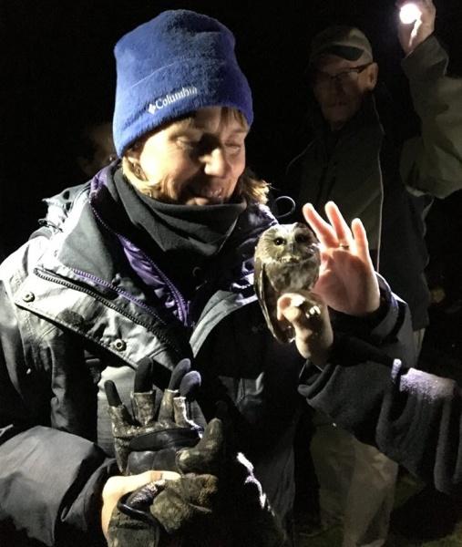 Donna Foyle pets the owl (photo courtesy Donna Foyle)