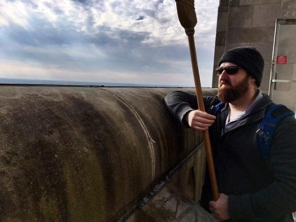 Jason holds the broom for head-protection (photo courtesy Bob Mulvihill, National Aviary)