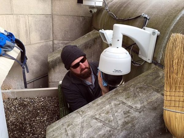 Jason cleans the webcam's protective dome (photo courtesy Bob Mulvihill, National Aviary)