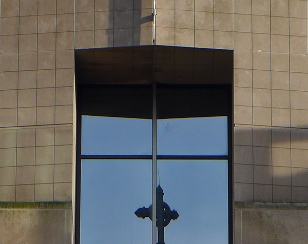 Front door vault at SEI with peregrine smudge on sky-background of top right glass (photo by Kate St. John)