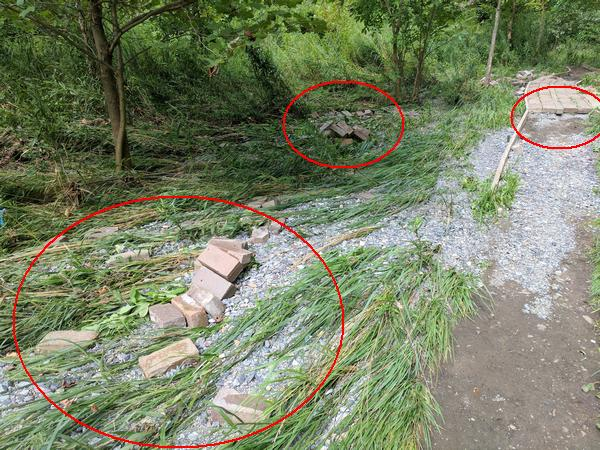 The flood carried away bricks from the walkway next to Nine Mile Run in Frick Park (photo by Kate St. John)