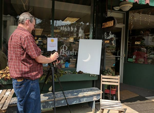 After moving the projection pallet into the shade, Doug Cunzolo adjusts the scope (photo by Kate St.John)