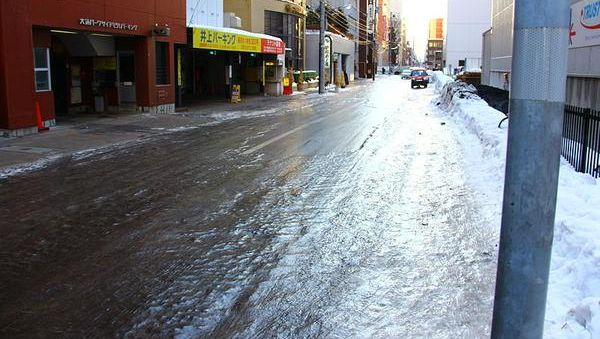 Transparent ice coating the street in Sapporo, Japan (photo from Wikimedia Commons)