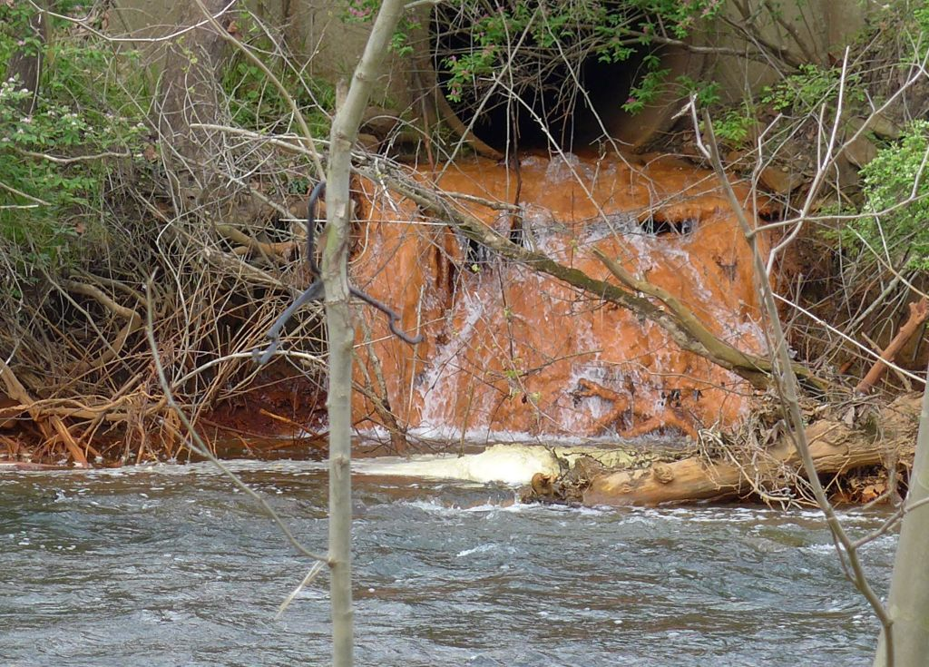 Orange ferrihydrite water pollution from abandoned mine drainage, Chartiers Creek, April 2016 (photo by Kate St. John)