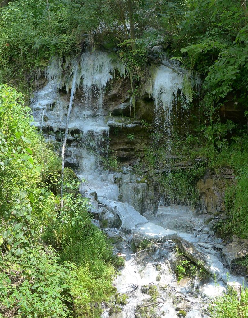 Waterfall stained white by abandoned mine drainage, Allegheny County along Yough River Trail (photo by Kate St. John)